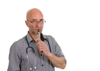 Doctor in shirt thinking with a pen in his mouth