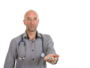 Doctor in shirt offering handful of drugs