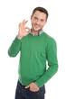 Mann lachend in grün mit einem Handzeichen für excellent.