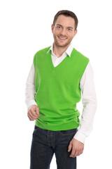 Junger lachender Mann isoliert in grünem Pullunder