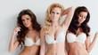 Three beautiful women modeling white lingerie