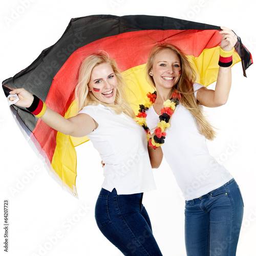 Two girly soccer fans having a party - 64207723