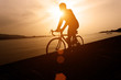 silhouette of a cyclist at sunset