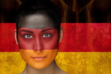 Composite image of beautiful football fan in face paint