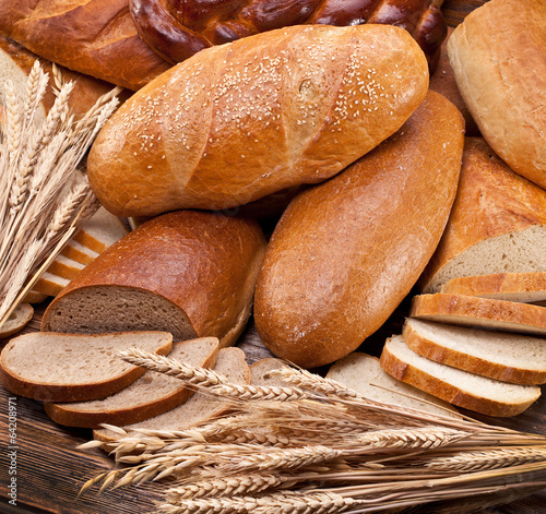 Fototapeta Bread and wheat. Food background.