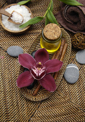 Spa treatment. Aromatherapy. Essential Oil. orchid, stones,