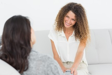 Therapist smiling at her patient
