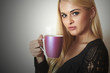 Happy Beautiful woman drinking Coffee.Blond Girl with Cup of tea