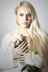 Beautiful Blond Woman with Roses.girl and Flowers.white bouquet