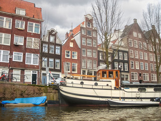 Houses and boats on the canal in Amsterdam . Netherlands