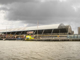 Embankment and the railway station  in Amsterdam. Netherlands
