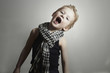 fashionable little boy in scarf.fashion children.Funny Child