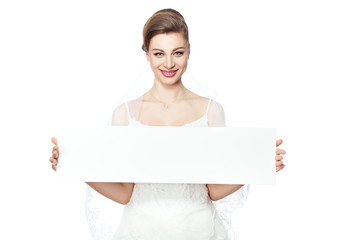 Bride is holding a billboard.