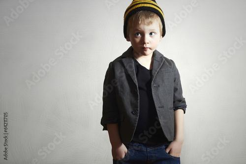 Funny little Boy.grunge cap and jeans.blazer.Fashion Children