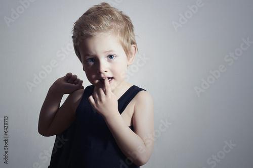 fashionable little boy.handsome blond kid