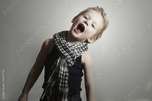 fashionable little boy in scarf.fashion children.Funny Child