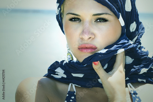 beautiful woman on the beach.Arabian style.Summer.freckles