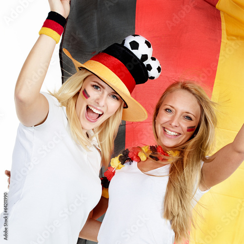 Two girly soccer fans celebrate the victory - 64211990