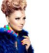 Beauty woman portrait in fashion blue fur coat