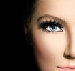 Beauty makeup for blue eyes. Part of beautiful face closeup