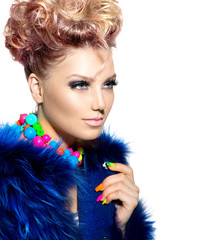 Beauty woman portrait in fashion blue fur coat