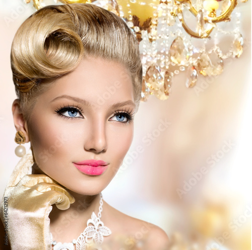 Vintage styled girl with perfect make up and hairstyle