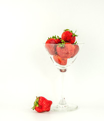 Strawberry on a background of white, gray.