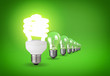 Idea concept with light bulbs on green