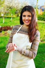 Happy beautiful woman standing in garden