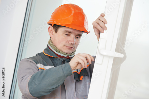 Male carpenter at lock installation