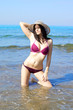 One perfect body female model with hat in the sea