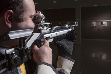 Close-up Of Man Shooting Target