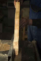 Man cutting wood by circular saw blade