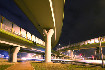 Highway in the big city in night