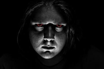 Dark evil face on black background