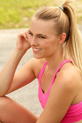 Pretty blonde fitness woman outdoors