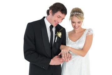 Newlywed couple looking at wedding rings