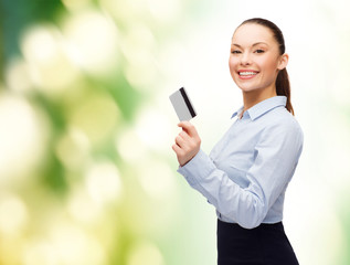 smiling businesswoman showing credit card