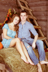 pretty young couple having dating in the hayloft