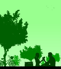 Romantic couple in picnic in park silhouettte