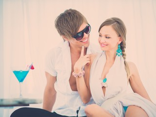 Young sexy couple relaxing on summer cafe terrace