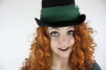 Irish woman with red hair wearing hat