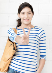 lovely teenage girl showing v-sign
