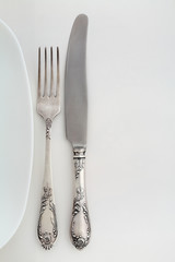 Vintage fork and knife near the plate