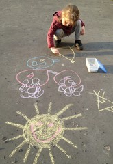 child painting with chalk