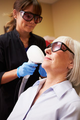 Woman Having Laser Treatment At Beauty Clinic