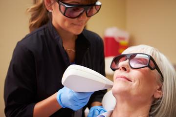 Woman Having Laser Treatment At Beauty Clinic