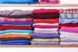 Pile of colorful clothes - 64228939