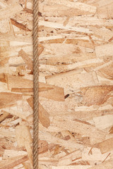 Rope lying on oriented strand board