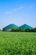 Leinwandbild Motiv Getreidefeld und Biogasanlage im Frühling